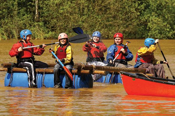 Groups of people on make-shift rafts