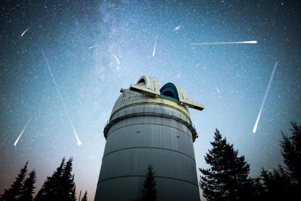 Astronomical Observatory with asteroids and comets in night sky