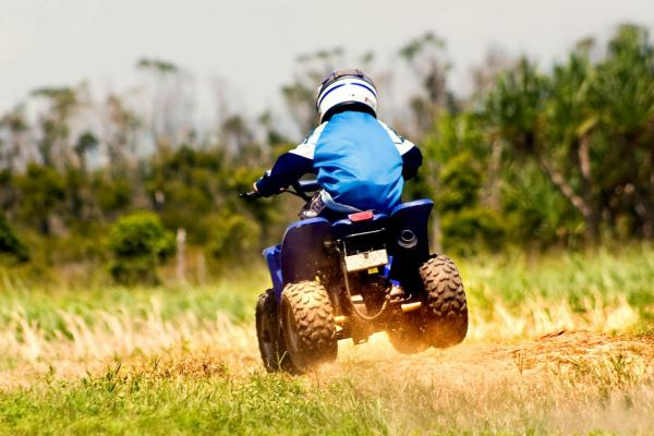 Boy having fun on a Quadbike