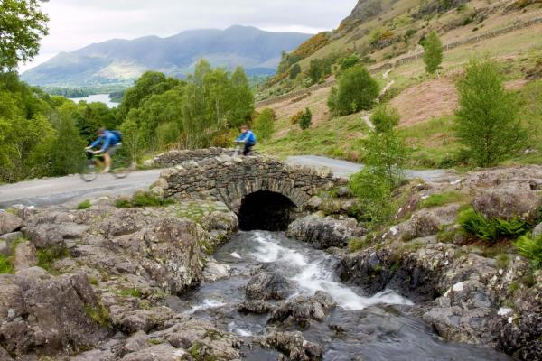 Couple cycling in the Lake District, Cumbria