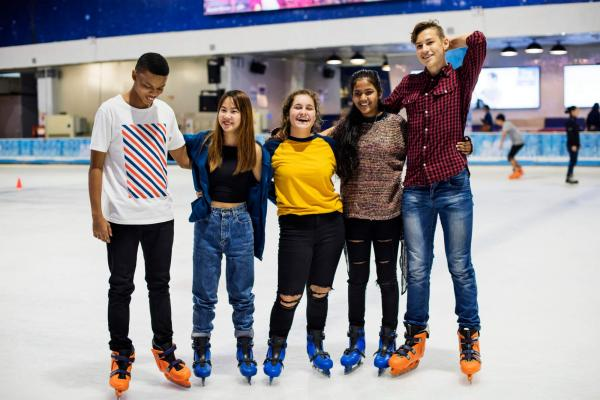 Teenagers ice skating