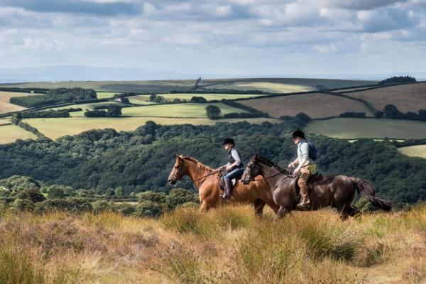 a couple of horse riders on the Devon moors