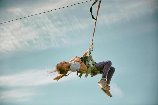 Child having fun on a zipline