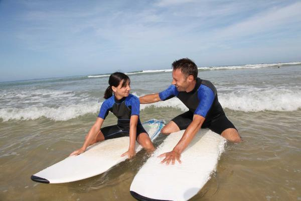 2 people on surf boards