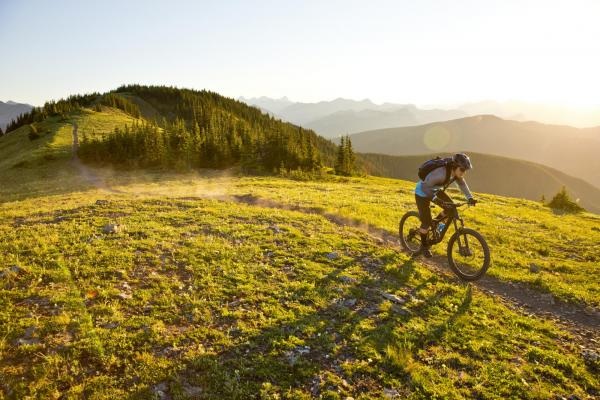 Mountain Biker on a track on the tops