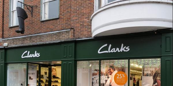 Clarks Shop and a hanging Clarks Boot sign