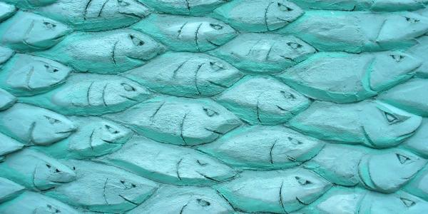 An arty fish textured facade outside a cornish fishmarket in Cornwall