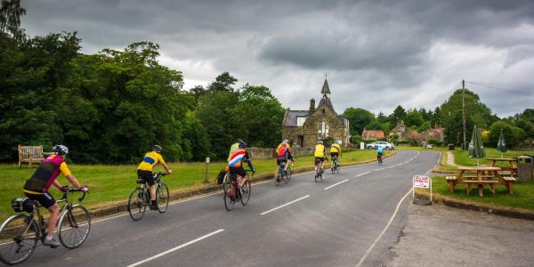 Cyclists in village in Yorkshire