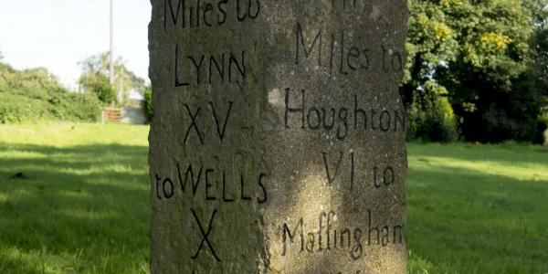 Norfolk milestone showing distance to Houghton, and to Wells