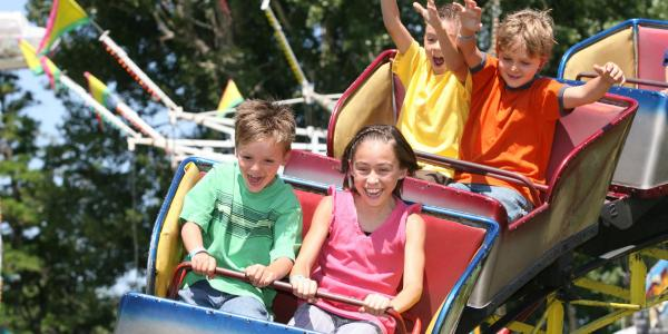 Children riding a roller coaster