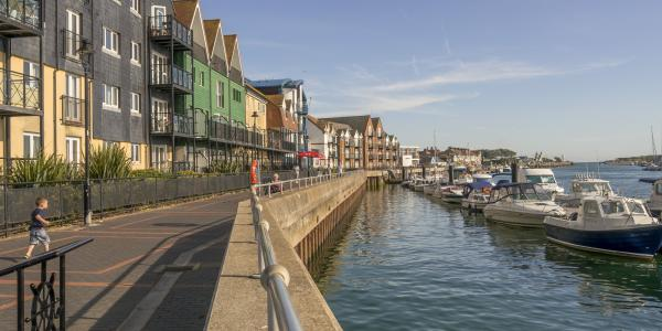Littlehampton riverfront, with apartment houses and moored river cruisers